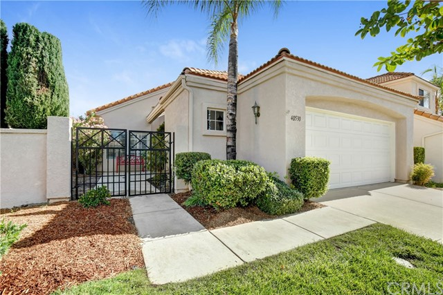 "Located in the resort style 55+ guard gated ""The Colony"" community.   This well-maintained upgraded home has a gated courtyard entry with many upgrades including, plantation shutters, new laminate flooring and ceiling fans throughout. There are many architectural accents, including a wet bar, niches and vaulted ceilings.  The bright kitchen features GE profile stainless steel appliances, white cabinets and brushed nickel hardware and opens to the casual dining area.  There are several fruit trees in the backyard and two covered patios to enjoy the tranquil views of the lush greenbelt through the wrought iron fence.  The community amenities offer resort style living with a gorgeous club house, billiard room, pool room, fitness room, lounge area, tennis court, golf course, pool, spa and more.  Great central location with easy freeway access, close to shopping, hospitals and movie theater."