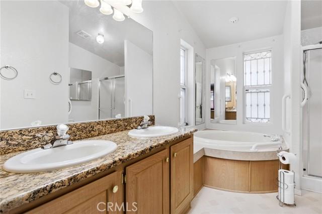 Primary Bath w Dual sinks and granite countertops