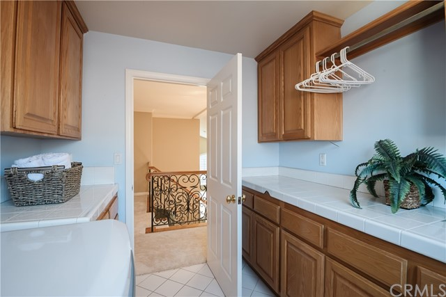 Individual Laundry Room with abundant cabinetry.