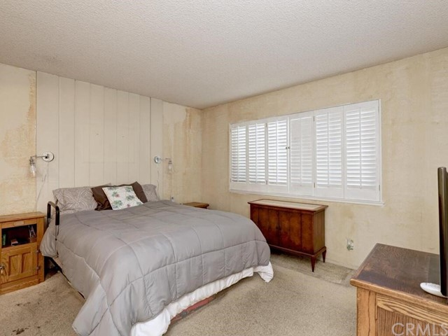 The large Master Bedroom features plenty of light coming in through the window and an attached Master Bathroom.