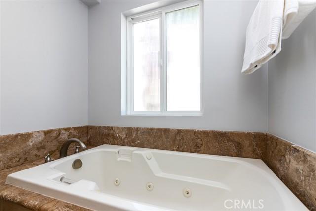 Jacuzzi tub in primary bathroom