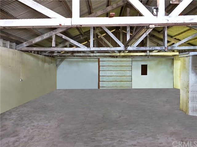 Expansive interior w/ a temp wall that has even MORE space behind it!  (Digitally cleaned & enhanced)