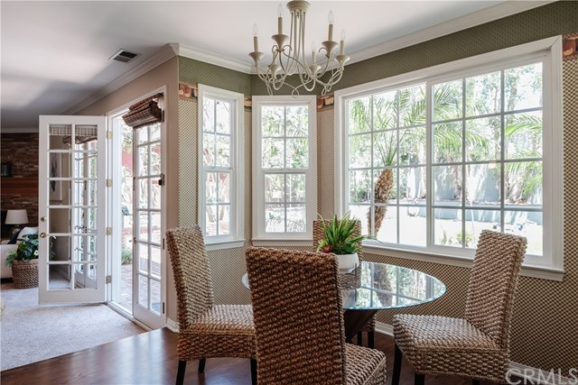 How lovely is this informal Dining area and view into back yard?