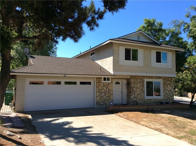 This charming property has 3 Bed/2.5 Bath, situated on a corner lot with spectacular views of city lights. Newer remodeled kitchen, dining and family room that walks out to a spacious backyard. Newer floor throughout the house and newer garage door and opener. Dual pane windows.  Perfect location for Diamond Bar High School, 10 and 60 freeways.
