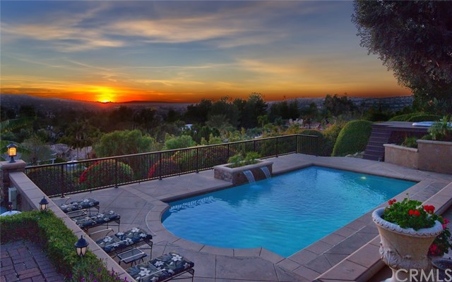 Stunning Single Story View Home in Anaheim Hills!!!  This Beautiful Home is an Entertainer's Dream with its Panoramic Views, Remodeled Pebble Tec Pool, In-ground Spa, Built in BBQ with eating area, Gas Fire Pit, & Gorgeous Decking!  There are steps that lead down to an additional grassy area that connects to the horse trails. Disneyland Fireworks can be seen every night!  No expense was spared when this single story home was remodeled.  The kitchen is gorgeous & features granite countertops, tall white cabinets, large island, 6 burner gas stovetop,  double oven, microwave, dishwasher, & large dual pane windows that look out to the beautiful view!   The home features raised ceilings that have gorgeous beams & quality finish work.  There are 3 Bedrooms & an office that could potentially be converted to a 4th bedroom. All 3 bathrooms have been remodeled and feature high quality cabinetry & countertops. The family room & living room have a double sided fireplace & new laminate flooring.   In addition to the 3 car garage, there is a gated 52' RV parking area with hookups. There is additional parking on the other side of the house next to a large shed for storage.  The home has 2 AC units & a whole house fan.   This beautiful ranch style home sits on a private street with no one on the other side of the road.   It's a one of a kind dream home!!!