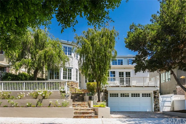 This 5 bedroom 5.5 bathroom Cape Cod style home is drenched by natural light as it sits high on the hill in the Manhattan Beach tree section. With 4150 square feet of interior space, this home features formal and informal living spaces with high ceilings and hardwood floors throughout. The main floor includes formal living and dining as well as large kitchen great room open to back yard. The kitchen is spacious and open with large eat at island, kitchen nook, professional grade appliances and butler s pantry. There is also an office/bedroom with en suite bath and closet. Upstairs are three additional bedrooms, including a luxurious master suite Below, on the first floor, is a huge media room, a wine room, a guest suite and an immaculate three car garage with added storage. Amenities include custom walnut floors, three fireplaces, stunning spiral staircase, custom California Closets throughout, air conditioning, Nest system and central vacuum. Built by master home builder Dave Odle in 2007. Available October 2nd.