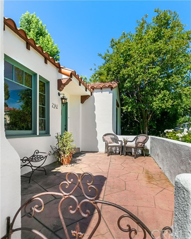 Welcoming Front Patio surrounded by Lush Gardens