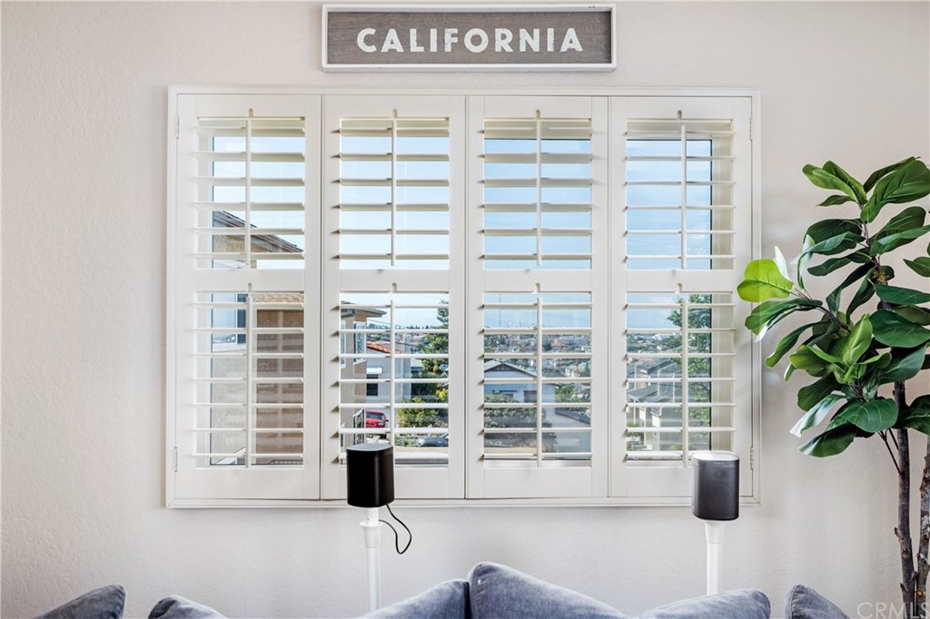 View from living room through beautiful wood shutters that continue through the entire unit.