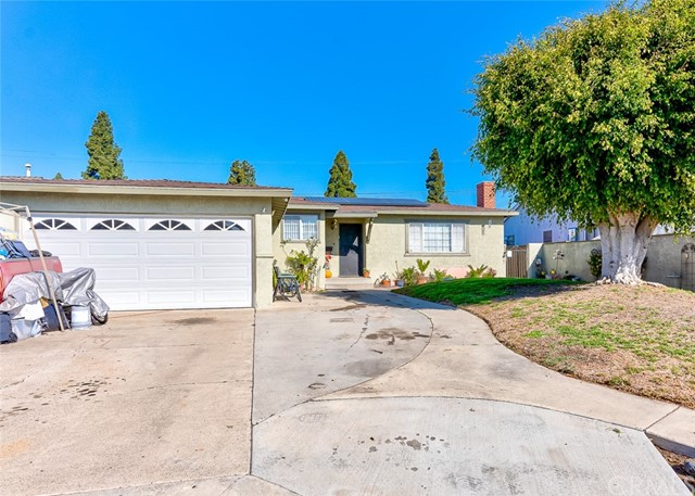 Huge potential!  Conveniently located in the City of Garden Grove, this single-story, south-facing home has 6 bedrooms, 3 baths (1 full, 2-three quarter), 2 kitchens, 2 pantries, on a large 8,457sf lot.  There is a 2-car garage, a large driveway good for 4 cars, and plenty of street parking.  In the backyard, there are two 15' sliding gates for easy access to the alley.  Solar is leased.  Quiet neighborhood, convenient access to Freeways 5, 22, 405, and 91.  Minutes from Disneyland and Knotts Berry Farm; walking distance to The Promenade shopping mall.  Shown by appointment only.