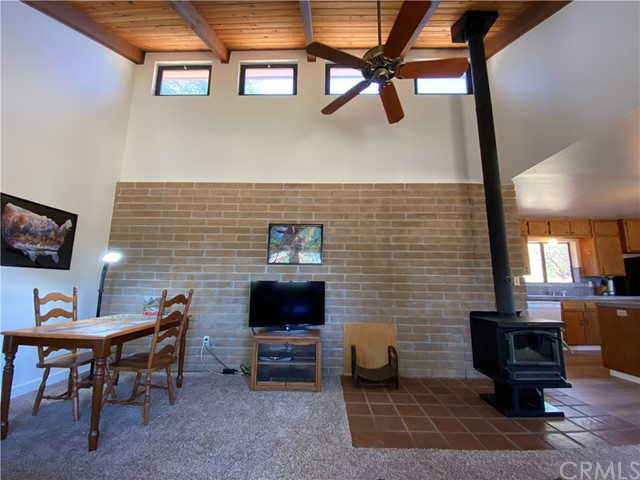 Great Room has knotty pine vaulted ceiling and cozy wood stove.