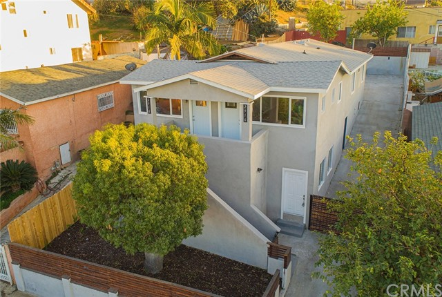 Location! VIEWS! TRULY ONE OF A KIND!!! 3 UNITS centrally located in the heart of Boyle Heights! LIVE IN 1 & RENT THE OTHER 2! Peek a boo views of the DTLA skyline & beautiful San Gabriel Mountains! EXCELLENT UNIT MIX! Top story consists of side by side units, each w/2 bedrooms & 1 bath. Both upper units have rear exits leading to the newly hardscaped spacious yard.Open floor plans which encompass the living room, dining area as well as kitchen. Newly installed modern gray laminate wood flooring throughout.The long hallway lined w/new recessed lighting, leads to both bedrooms as well as the bathroom. North facing living rooms in each unit= plenty of natural light illuminating the space. ! bdr/1 bath downstairs. All 3 units have newly installed kitchen cabinets & custom granite countertops.Newer light fixtures & recessed lighting throughout!Long driveway leads to the rear yard & a spacious newly cemented area=plenty of parking. Drought tolerant land/hardscape. Established citrus trees at rear. Walk Score® of 66.TransitScore® of 51.Close to public transport, shops, restaurants, schools, Cal State LA, DTLA & various fwys: 10, 60, 710, 5 & 101 fwys. About 1.1 miles from the Metro Gold line (Runs from Azusa/East LA).Short distance to several Metro bus lines. Info deemed reliable but not guaranteed. Buyer to verify all info & entire condition on their own & must satisfy themselves as to all aspects of this property.