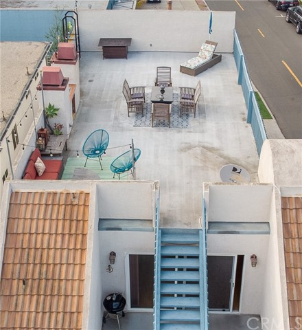 Stairs up to large rooftop deck