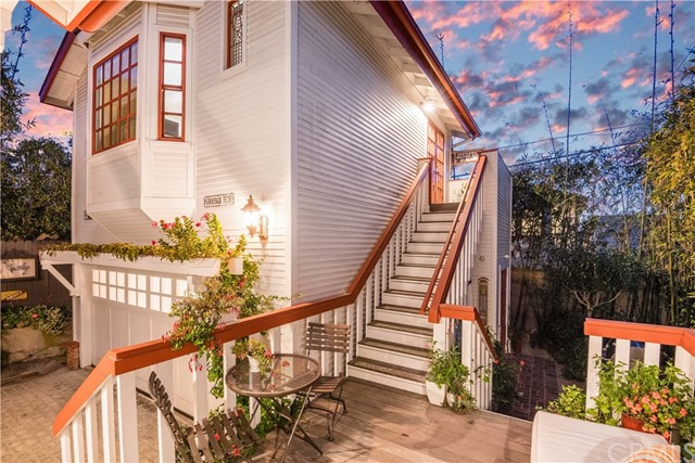 Fabulous sunsets from the 1981 built guest house - remodeled in 2017. The 1st level is currently being used as a garage/studio but could be converted to an ADU and used as living quarters with rent potential.