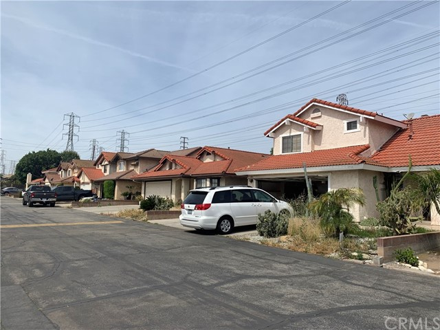 Convenient location, gated community, detached two story condo unit. Easy access to freeway 60.