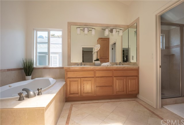 Great Primary Bathroom with jetted tub, double sink vanity and separate shower.