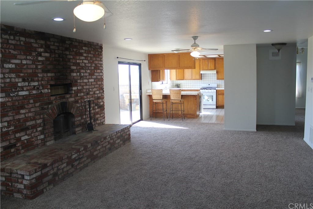 This newly renovated 2,500 sqft. home has 3-bedrooms, 2.5-baths, and is ideally situated on 5-flat acres with mountain views. Must see to appreciate its many features. Beyond the private gate, enjoy amazing privacy with no neighbors on any side, and room to play. This home is very peaceful and quiet on the inside with endless possibilities outside. The floorplan is great for entertaining and features a spacious family room adjacent to the open kitchen. The warm family room features a beautiful brick fireplace, plenty of natural light from the many windows, and opens to the expansive yard w/covered patio. The living room has vaulted ceilings and opens to the dining room and kitchen. Off the master bedroom is an extensive balcony perfect for sunbathing, and enjoying your morning coffee while taking in the views. The two secondary bedrooms are perfectly sized. There is plenty of room for RV parking, horses, work trucks, toys & more. It's a great location with quick access to the 215, shopping, Loma Linda hospital & Kaiser. Vista Murrieta High School & Oak Meadow Elementary are both within a mile. No water bills as this home has its own well. You must see this home to appreciate its many features and tranquility