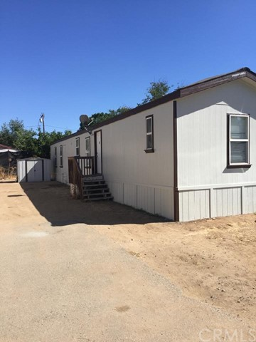 9 Manufactured homes, not on permanent foundation, on an approximately 74,487 sq ft lot in Wildomar. 3 APNs are part of this sale. The Addresses are 21521 Waite St, 21517 Wait St and APN #366-182-057. 9 units are 3 bedrooms, 2 baths & 990 sq ft. 1 unit is a double-wide with 2 bedrooms, 2 baths, approximately 1,400 sq ft. Most units have vinyl flooring and some units have carpet. All units have washers, dryers and refrigerators. Almost all have central heat and air. Seller states 1 unit has a cooler. All units have natural gas, city water & electricity. Seller collects rent & pays all utilities. Seller states all units are on leases.