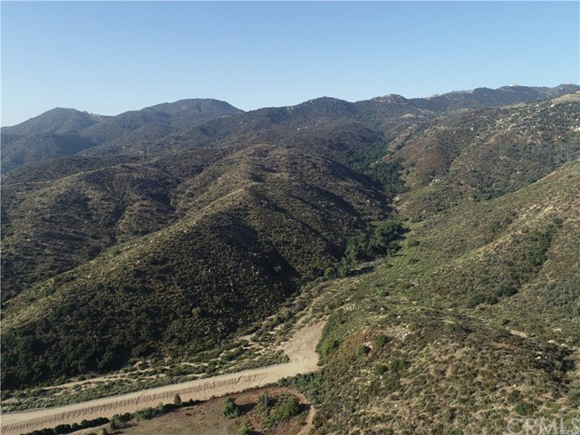 The property consists of 168.87 acres of prime Rural Residential zoned land in Wildomar, Riverside County, California. The site is located adjacent to residential and commercial developments. The zoning Rural Residential allows for 5 acre minimum lots. However, the land use is Rural Mountainous which requires 10 acre minimum lots. The front section at street level allows 2 acre minimum lots. The subject property is located in an area of new construction at one of Wildomar's most prominent locations. Many development opportunities exist for this property, which is ideally situated. The site is in close proximity to several other current and future commercial developments, making this area one of Riverside County's largest and newest development centers. In addition to major retail developments. Description includes APN additional 382320003-3, 382320014-3