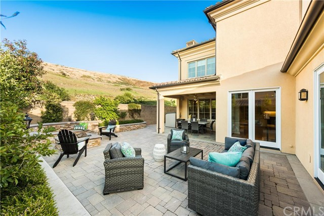Escape the world and enjoy the tranquility behind the gates of newly developed Laguna Altura. Nestled in the hills of South Irvine, this Toscana Residence 3 boasts 3236 SF of gracious living on a premium 4820 oversized lot at the end of cul-de-sac location adjacent to rolling hills and peaceful nature trails. This 4 bedroom, 4 En-suite bathroom home plus loft has more upgrades than the model! Enjoy Provenza Wood Flooring, Formal Entry with open Living Room  and extended Dining Room. Inviting fireplace. Large Pocket Doors line the back wall for plenty of morning sunshine! Downstairs full bed & bath. Chef's dream kitchen with oversized island with Santa Cecilia granite, wine refrigerator and veggie sink. Thermador kitchen appliances. Enjoy clean air and water with Whole House Electronic Air Purification System and Reverse Osmosis Water Filtration System. Feel secure with Security System C-M with pet-immune motion sector. Enjoy your music and entertainment with 5.1 Surround Sound with 3x room Audio Speakers. Professionally landscaped yard with covered patio, fire pit and spacious yard. Ideally located in Orange County only minutes from Laguna Beach while being conveniently located next to shopping and entertainment. Award-Winning Irvine School District.