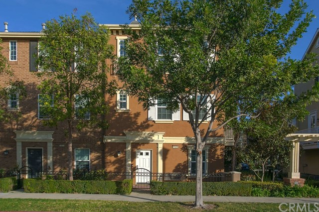 """Stunning Camden Place end unit Town home is available in the sought after community of Columbus Square in the centrally located Tustin Legacy. Enjoy a great location in the neighborhood a short walk to the clubhouse and village green. This popular floor plan with 9 ft ceilings has three levels that include a bedroom suite on the entry level along with access to the attached 2 car garage and inside laundry room. The spacious great room on the second level has gleaming hardwood floors and another bedroom and bath that are stunning! Granite counter tops, dark stained cabinets and stainless steel appliances accent the gourmet style kitchen. This home includes a kitchen balcony that is perfect for a barbecue, a must for the chef in the family! Perfectly situated on the upper third level is the luxurious master suite that offers a quiet respite from life with a fantastic soaking tub, separate shower and huge walk-in closet. Enjoy Southern California evenings on your large front patio and walk down to all of the amenities that living in Columbus Square offers you including several parks, clubhouse with exercise room, pool, spa, sport court and many community activities! Located close to the popular """"District"""", walking distance to the Village of Tustin Legacy shopping center, freeways, OC Airport and beaches. Zoned for Heritage Elementary School, a STEAM school and the under construction Legacy Academy middle and high schools."""