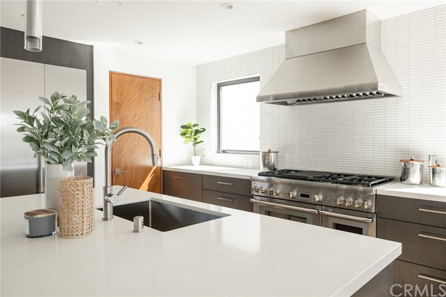 Decandent kitchen with premium appliances and walk in pantry