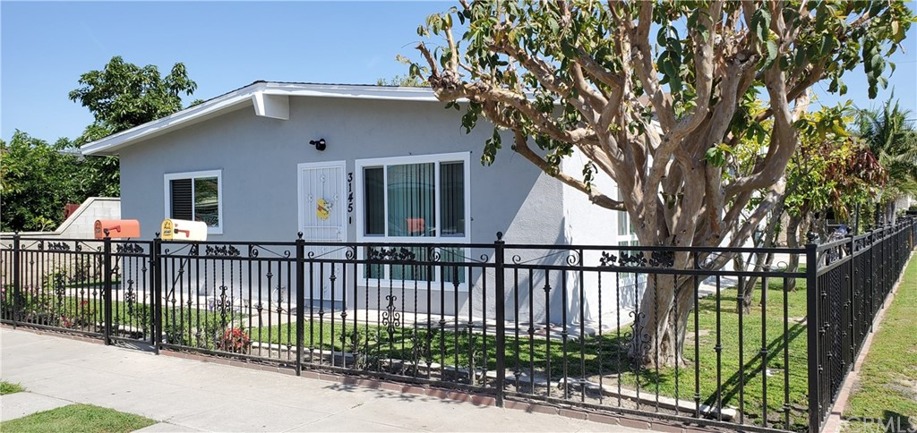 Rare Corner Location Paramount Duplex! Great Investment Opportunity or Live in one and use the income of the other to qualify. Possible FHA financing with 3.5% down. Both units have new exterior paint and all new low E vinyl windows. Large wrought iron fenced yard with fruit trees. Unit one 3145 is a single level home with 3 bedrooms and recently remodeled bath (another full bath in oversized one car garage), living room with beamed ceiling, formal dining area and kitchen with granite counters. Unit two 3147 is above an oversized two car garage and features one bedroom, remodeled bath, living room (could be bedroom 2) and dining in kitchen. The oversized two car garage has been split in to 2 oversized one car garages (one for each unit). Separate gas and electric meters. Long term tenants Leasing month to month. Property is close to freeways, shopping centers, dining, parks and schools. Excellent corner location with lots of parking.