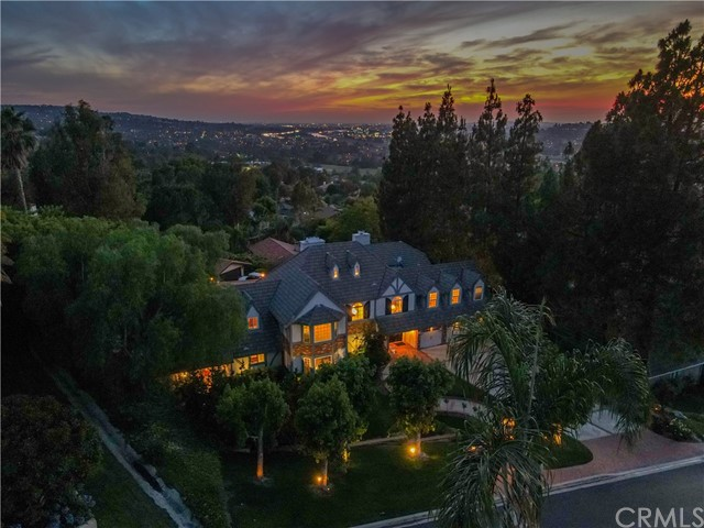 *ENTERTAINING OFFERS BETWEEN $1,450,000-$1,550,000* Up in the hills of exclusive Owens Drive, this Spectacular Custom Tudor Estate offers privacy & boasts an entertainer's utmost desire of curb appeal: Offering 5 Bedrooms & 4 Baths, this exquisite manor rests on 1/2 acre property & offers approx. 4,665 square feet of abundant living space. Located on a private street where all homes are custom built, this home has a Fantastic floor-plan w/4 bedrooms upstairs & one bed/full bath downstairs, perfect for in-laws/out-of-town guests. Traditional interior w/French doors everywhere you look, 2 fireplaces, & hardwood flooring. Remodeled Kitchen Features Newer Cabinetry, Center Island, Stainless Steel Appliances & intimate Dining area. Formal Dining Room offers Dual French Doors which lead to Breathtaking Views of Backyard Pool & City Light Views. Master Suite has a spacious retreat & private view balcony. The Great Room is grand w/30' Ceilings, Custom Cabinetry Built-Ins, a true masterpiece of a Fireplace surround, Wet bar, & Upstairs Loft Area which makes a perfect space for a billiard table, social gatherings or quiet nights at home. Leading to the serene backyard you will find the pool, spa, gazebo,& sports court while surrounding yourself w/ the sunsets & views of a truly one-of-a-kind property!3 Car Garage w/Long Driveway that accommodates multiple vehicles. Rare Location in a totally rural area that has deliberately maintained its nature-forest like appeal!