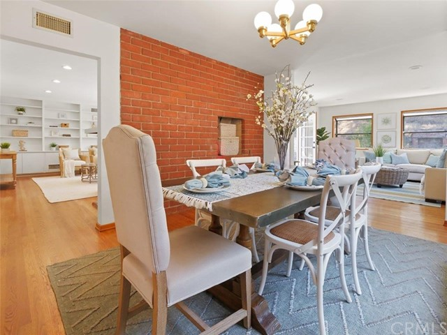 Formal dining room with a built-in barbeque grill. There is a living room to the left and a family room to the right