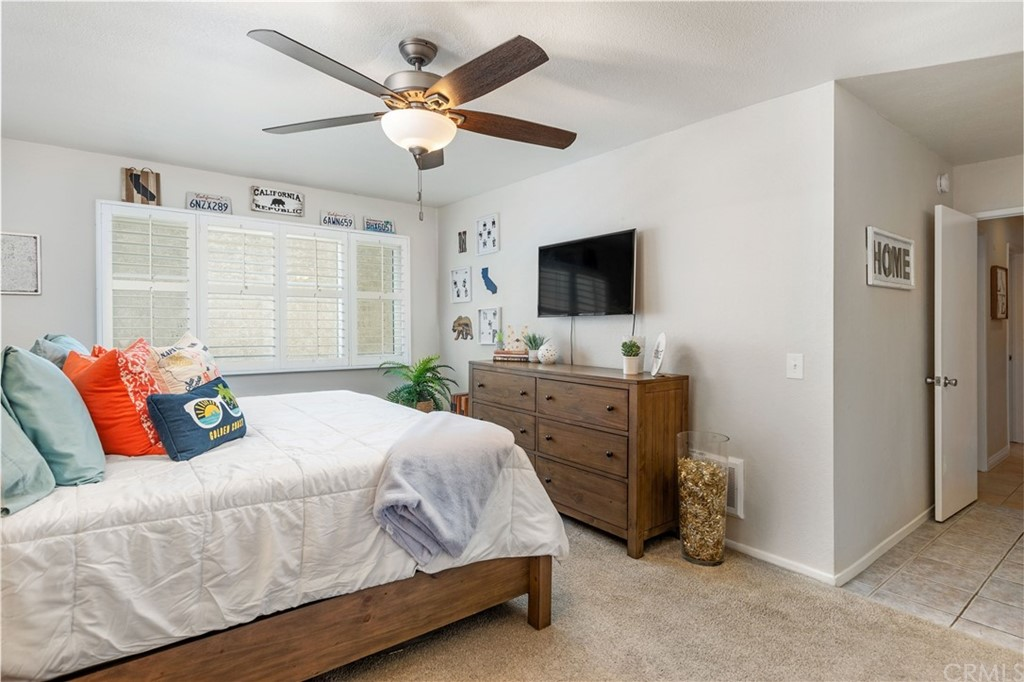 Note ceiling fan and wood shutters in every bedroom.