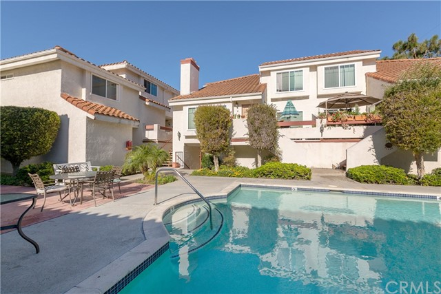 Charming and Pristine 2 bedroom 2 and a half bath Town home located in the heart of the city!  Bright and spacious front unit in the lovely community of Gramercy Gardens East.  You're steps away from Old Torrance Park and a short drive to newly renovated Del Amo Fashion Center and AWARD WINING TORRANCE SCHOOLS including John Howard Wood and John Adams Elementary, J.H. Hull Middle and Torrance High. The living room, kitchen and dining area feature a seamless open floor plan with an updated kitchen, breakfast bar and a separate dining area over looking the living room and the cozy fireplace.  Spacious balcony that's perfect for entertaining. The upstairs spacious master has high vaulted ceilings and a cozy sitting area and over sized closets with an en suite bathroom. The second bedroom is located on the second floor adjacent to a full bath.   Laundry room located in between the bedrooms with stack able washer and dryer. OTHER FEATURES INCLUDE:  Dual pane windows installed in 2011.  New water heater installed in 2004.  Kitchen remodeled in 2009 with new cabinets, granite counter tops, stainless steel appliances. Two patios, private 2 car garage located below unit, no direct access but close by.  Gramercy Gardens East is a peaceful, quiet 18 unit gated complex nestled in lush landscaped grounds with a pool (not heated ) and Jacuzzi (heated by timer).  Low HOA dues of $320/mo. INCLUDES ALL EXCEPT GAS, ELECTRIC, PHONE AND CABLE.  BUILDING IS NOT FHA APPROVED.