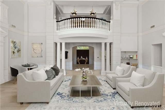 Living room - virtually renovated to show updated flooring, paint, furniture and decorative treatment.