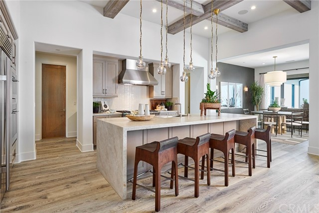 Kitchen and dining room, model home shown.
