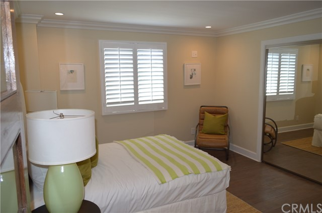 Upstair bedroom with plantation shutters for added privacy.
