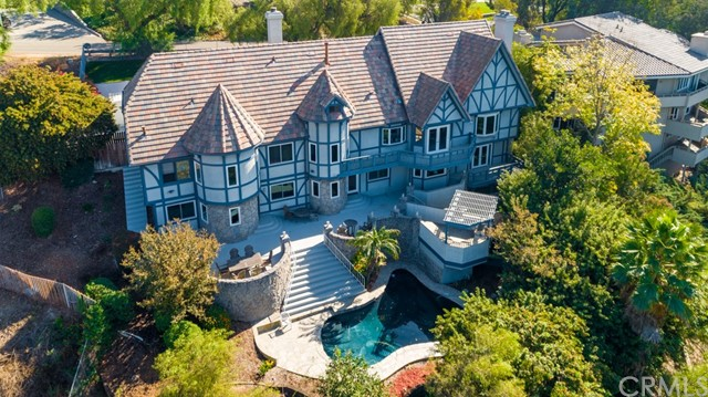 Views, Views, Views!!!  Seller will entertain offers between $1,870,000 and $2,200,000.  Fabulous custom built home with many upgrades shows like a model home!  As you enter this lovely home you will be overwhelmed by its open airy and functional floor plan!  Enjoy spectacular sunset views from the formal living room with fireplace.  Home also boasts formal dining room, exquisite spacious eat in kitchen with an abundance of cabinetry and upgraded appliances.  You will love the spectacular views from the kitchen!!!  Cozy family room with fireplace and many built ins!  Four spacious bedrooms with generous closet space, dream master suite with fabulous large shower, tub and dream walk in closet!  Utility Room, office and every closet in the home was custom created by California Closets.  Step out onto the balconies and you will be mesmerized by the breathtaking views!  Rear of home has in ground pool, barbeque grill and trees, trees, trees which provide a tranquil, private setting!  3 car garage has tons of storage and cabinetry along with Versalift which allows for easy access to attic storage area from garage. Home has quality wood work and stain glass windows!  All windows in the house except for toy room, garage & 2 side windows in living room have been replaced with energy efficient Anderson windows. Walk up attic is nearly 1,500 square feet and can easily be developed into living space!  Truly a sensational property!  Listing agent is related to seller.