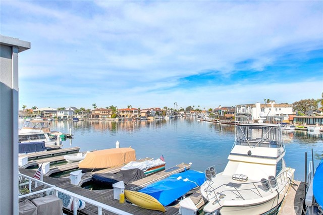Very Rare Opportunity to own on the water with your own 32ft Boat Slip in the most desirable complex on the Harbor called Weatherly Bay!   This upgraded Townhome features expansive open channel views, a large sundeck with Trex decking, and power shade awning. The interior features dual suites located upstairs with full bathrooms, upgraded fixtures, walk in tile shower in master, bathing tub in secondary suite, designer ceiling fans, wood floors, two large separate closet spaces in the master, and balcony with water views & glass railing system.   The downstairs area features a large family room with mirrors & water views, custom wood paneled gas fireplace, large designer kitchen with granite counters, GE stainless refrigerator & dishwasher included, electric cooktop, pull out trash system, ample wood stained storage cabinets, ceiling fan, laundry room, and storage room under the stairway.   The complex features a large community pool with umbrellas, tables, changing rooms, full size tennis courts, and large grass area with dog runs! The community residential buildings were recently painted in 2019 with two tone designer grey and white tones.  Hurry this property will not last long as it stands head and shoulders over any other townhome community on the Harbor. Location, Location, Location!