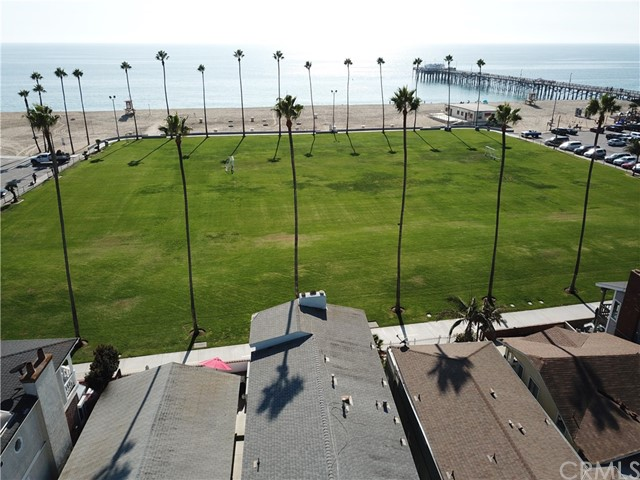 916 E Oceanfront is a prime location oceanfront duplex on the boardwalk. This lower unit is a 2 bed 2 bath with STLP permits, with a very desirable ground floor patio. The upper unit is a 3 bed 2 bath with STLP permits with a private balcony and panoramic ocean views. Directly on the boardwalks and the grassy Balboa Park, with the sand and the water straight ahead. The property is just two blocks from the Balboa Pier and Balboa Village, full of shops, restaurants, bars and activities.  Each unit in this building gets ONE parking space in the carport. The carport is a little tight to maneuver in and out of, but nearly any regular vehicle will fit.  NOTE: There is construction ongoing next door that should result in a public alley in the near future. Currently the property's parking is accessed via 919 East Balboa, a separate unit, in exchange for the use of one parking space at 916 East Oceanfront. As a requirement of this sale, any buyer will need to agree to abide by the parking arrangement until alley access is available. Buyer to verify alley situation.  NOTE 2: 916 East Oceanfront is no longer being sold in conjunction with 919 East Balboa. Please see separate listing for 919 East Balboa.