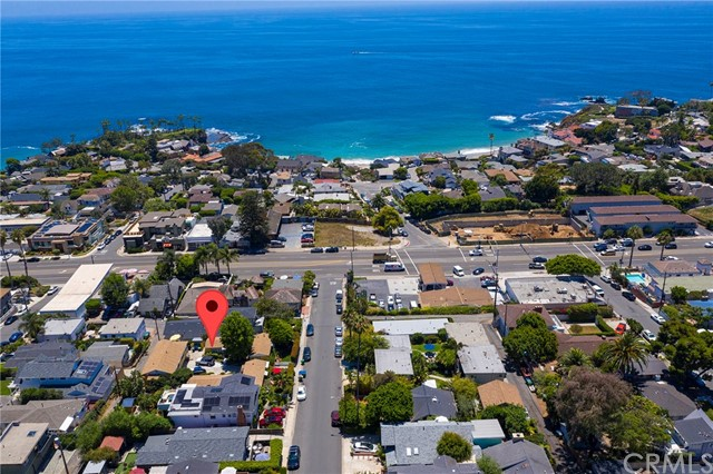 Your own private compound located just 2 blocks from the beach in prestigious North Laguna! Four cottages plus a carriage house (5 units total), and a 4-car garage, on 2 legal lots totaling 9,000 square feet. The 4 stand-alone bungalows are independent, each with about 470 square feet including one bedroom, a full bath, vaulted beamed ceilings, wood floors, fireplace and a full kitchen. In addition, there is a 2-bedroom carriage house above the garage featuring ocean views and a large deck. Altogether this property comprises 6 bedrooms, 5 bathrooms, 5 full kitchens, 5 living rooms, 4 fireplaces, the 4-car garage, a laundry room and a workshop. There is additional parking in the driveway and off the alley in the back. The lot is street-to-alley, and would support either one or two single family homes, or up to 5 multi-family units as it is currently configured. Live in one unit and collect income from the others, or connect them, or use them as detached studios, offices or guest rooms. Garage access could be easily moved to the alley, enabling the open space of the lot to be fully utilized: there is plenty of room for a spa, fire pit, bocce court... The possibilities are endless! All this just moments from Crescent Bay and Shaws Cove, plus all the shops and restaurants of North Laguna! The property currently generates over $11,500 in monthly income, all tenants have been long term and are currently on month-to-month leases.