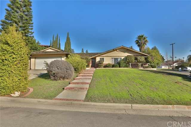 This wonderful home sits just across the street from the Los Coyotes Country Club! You must come and see it! Featuring 3 bedrooms, 2 bathrooms, an amazing open layout, 1,698 Sqft of living space, a large kitchen with an eating area, a huge living room with a fireplace, and a dining area! Other features include Original Hardwood Floors throughout and Central AC/Heat! The corner lot is a phenomenal size at 10,450 Sqft and features an attached 2 car garage and a covered patio! Thank you so much for viewing this home!