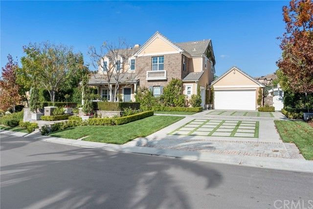 "Jaw-dropping entertainer's dream estate tucked within the exclusive Kerrigan Ranch neighborhood. This transitional East Coast style home boasts a sprawling open floorplan and every imagined amenity. Unbelievable curb appeal and an everlasting impression as you open the front door with gorgeous hand-crafted millwork, sparkling crystal chandelier and warming fireplace. Formal dining room offers custom built-in buffets and French door access to welcoming interior courtyard with fireplace. Granite and stainless kitchen enjoys top of the line appliances and walk-in pantry. TWO family bonus rooms are offered on the lower level with fireplace, entertainment niche and an expanded pool-table sized area with French doors leading to expansive backyard. Downstairs en-suite bedroom with interior courtyard access, generous laundry and powder bath complete the lower level. Upstairs leads to the private master suite with sumptuous spa-like master bath with jetted tub, walk-in shower, dual vanities and inviting view balcony. Three additional bedrooms, one en-suite, finish the upper level. Well over $100k Control 4 smart home system to operate security, AV, Cameras and lighting from anywhere.  An unbelievable ""Four Seasons"" resort style yard with huge party cabana, bathroom, outdoor kitchen, sport court, in ground trampoline, custom playhouse and grassy lawns will make every day feel like a vacation. Finished with an oversized 3 car garage and attends Yorba Linda HS."