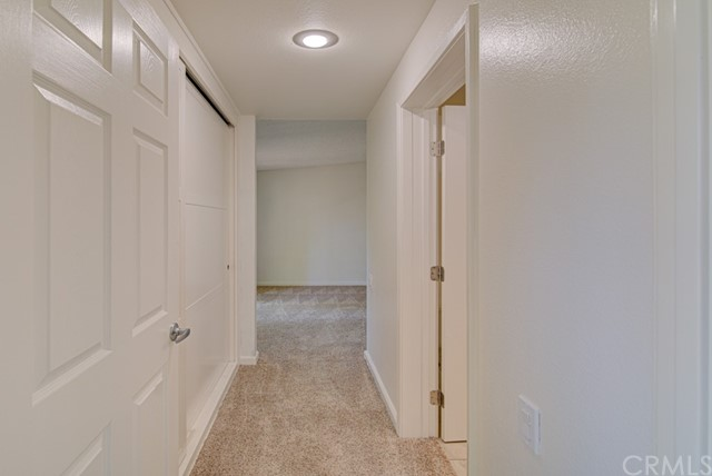 Hallway leading from the living room to the master bedroom.