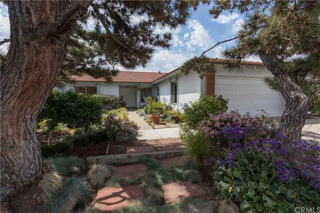 Welcome to 2030 N Williams, Santa Ana! This SINGLE LEVEL home is located on a quiet street and boasts so much charm! You will be greeted by the lush landscaping in the generous front yard space. Upon entering, notice the light and bright nature of this home with fresh paint and a clean, neutral palette. The numerous windows and sliding doors provide plenty of natural light. At the center of the home, you will find the kitchen and dining area. With neutral finishes and great views to the backyard garden, this would be a great place to entertain. Just off of this space is the generously sized Family Room, featuring a statement fireplace and sliding door with access to the backyard. The master suite has plenty of closet space and a private full bathroom. The other 3 bedrooms are of good size. The shared hallway bathroom features a shower/tub enclosure and spacious double vanity. The laundry room is just off of the garage and has convenient cabinet storage. Outside, in the spacious backyard space, take in the mature fruit trees. Luscious lemons and avocados are ripe for the picking! Conveniently located near shopping, restaurants and 91,5,and 55 freeway access, this home is a must see! Well respected Tustin Unified School District. Home has been virtually staged.