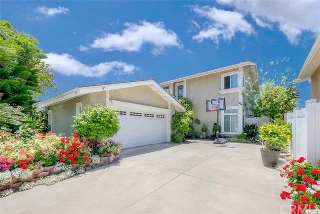Luxury living in the prestigious city of Placentia. Gorgeous Home w/stunning lush curb appeal nestled on a corner lot. Offering a 3 Bed & 2.5 bath layout, appx. 2,306 sq. ft. of abundant living space. Large open living room that flows to the formal dining room (currently being used as a bonus room/office). Remodeled kitchen w/granite countertop, ample cabinets space w/pull out drawers, walk-in pantry, gas range/oven, dishwasher, microwave & breakfast bar that opens to the family room w/fireplace & wet bar! Convenient main floor laundry room. Make your way to the second level, Huge Master bedroom w/view of Disneyland fireworks & Mountains, walk-in closet & 2 additional closets, en-suite bath w/soaking tub, shower & dual sinks, 2 remaining bedrooms are generously sized & share an oversized hallway bath! Nicely sized backyard plumbed for Gas & Electric BBQ, plenty of fruit trees & lush greenery! Bonus Features included: NEW AC/Furnace, NEW Vinyl fence, NEW Carpet, Dual Pane windows & doors, recessed lighting & much more! Oversized driveway for ample parking plus 2 car garage w/direct access. Low monthly HOA of $175 Inc. Pool, Spa & Tennis Court. Home is centrally located near great schools, dining, shopping, parks, entertainment & easy freeway commute. Don't miss this once in a lifetime opportunity! This one will not last!