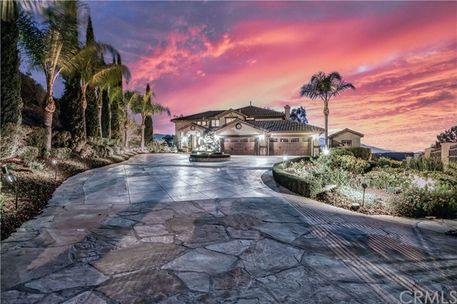 Welcome to 1862 Impresivo Drive, a timeless masterpiece resort estate.