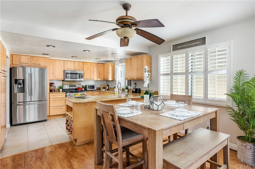 Open kitchen has it all!  Lots of counter and storage space, breakfast bar, stainless appliances, built-in wine rack.