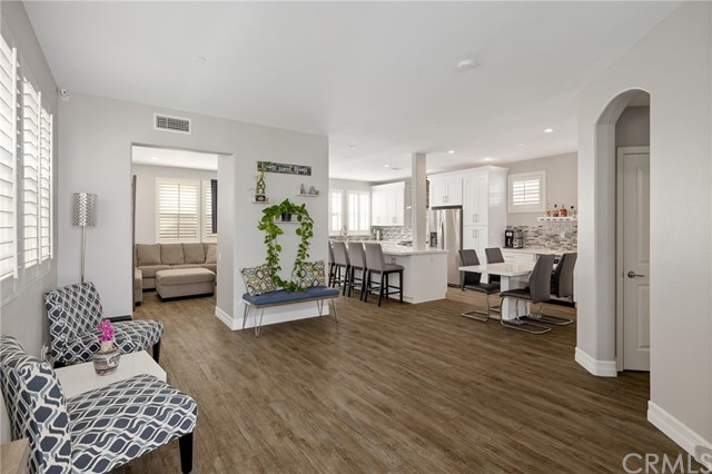 greeted by an open living floor plan