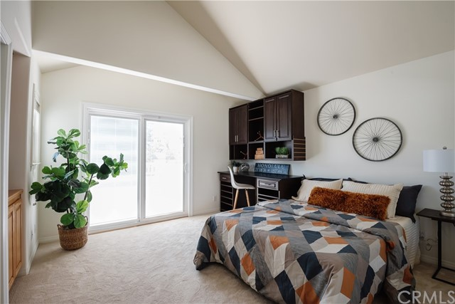 Vaulted ceilings, built-in cabinetry and desk in this great junior suite.