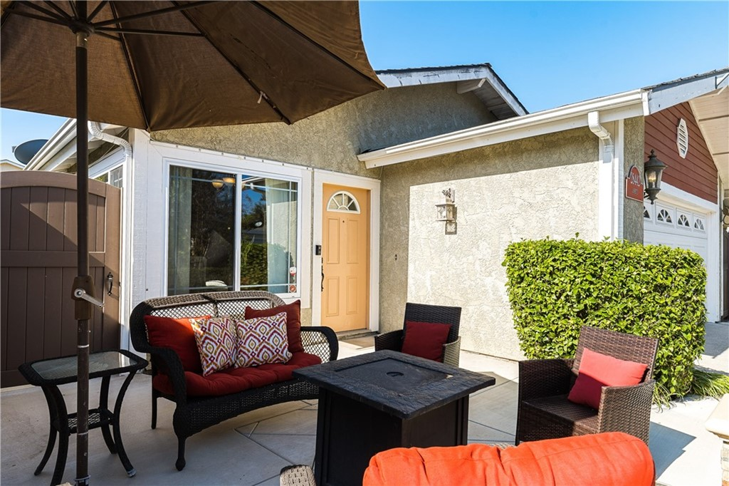 Fabulous location, cul-de-sac street, in a pride-of-ownership community, this single-story remodeled home provides so much! An entertainer's delight, this home boasts an open floor plan, a fabulous front patio & a large backyard complimented with a built-in barbecue with counter space, firepit to warm the cool nights, dining area, beautiful trellis, and privacy. Delight in the garden trees - 1 Fuji apple tree, 2 avocado trees, 1 lime tree, 2 fruit salad trees (lemon & oranges), 1 plum tree & 1 peach tree! Inside, the flow of this home is wonderful - light, bright, & spacious. Enjoy relaxing in the spacious family room or having family & friends over to enjoy a meal in the dining room opening to the patio. Cook together in the fabulous kitchen with a center island, enjoying the newer appliances - stainless-steel range, dishwasher, & microwave. The many cabinets provide wonderful storage & there is a spacious pantry with barn door too. You will appreciate the many improvements - owned soft water & reverse osmosis system, newer PEX piping, owned solar panels, tankless water heater, finished garage with epoxy flooring, pull-down ladder to access great attic storage space, LED can lights throughout, new fencing, & a Nest thermostat! The expanded master suite includes a sitting area w/sliding door to the back patio, providing a wonderful place to retreat & relax! Spacious secondary bedrooms.  Enjoy the proximity to Philip J Reilly award winning elementary school, Pavion Park, and the many walking trails! This home is in a lovely, quiet, neighborhood. Sprint to this home & make it your own!