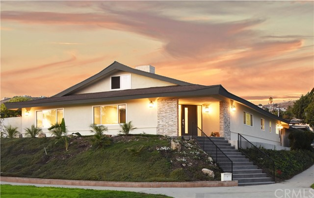 Be the first to occupy this extensively remodeled home, one block from the ocean on Paseo Del Mar.  A welcoming entry with vein cut marble & glass mosaic floors, designer wallpaper & crystal light fixture. The bright living room has fireplace clad in black onyx that wraps around into the great room. The master suite beyond the living room has custom walk-in closet, master bath with Carrera marble, dual sinks, shower and Euro style tub. The great room, kitchen and dining rooms flow in one large expanse from the entry with porcelain plank flooring uniting the space.  The kitchen has custom cabinets & an extra-large eat-at island; the backsplash & countertops are marble attaché. The dining area has custom wall-covering and a contemporary crystal chandelier.  Great room has a cozy fireplace section and a vaulted area with custom bar and space perfect for large screen TV gaming. French doors open to the patio and back yard for California indoor-outdoor living. The bedroom wing has two bedrooms, ample closets & full bath w/dual sinks & tub-shower. Another bedroom and full bath are near the laundry area. Large accessible attic.  New windows & air conditioning.  The two-car garage is entered from alley. Back yard has built-in bench seating, lush grass and patio next to the house perfect for bar-b-cue & dining table. The home is conveniently located minutes from Terranea Resort & Trump Golf Club & ocean side parks, shopping and freeways.