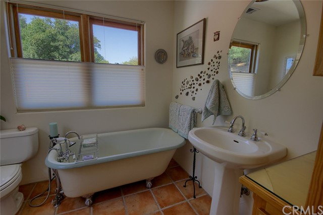 Master bathroom with vintage claw foot tub.