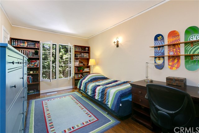 Third Bedroom with Hardwood Floors, Open-in Wood Windows and Wall Sconces